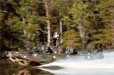 soldiers-in-camouflage-riding-in-speedboat
